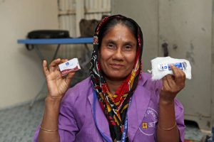 Fatema Akter, a BRAC community health promoter in Dhaka, holding the contents of a delivery kit