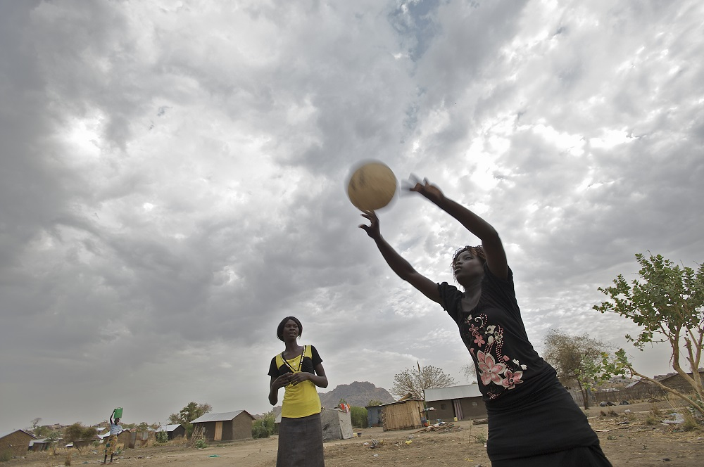Girls play volleyball outside a BRAC supported Adolescent Girls' Club in Gudele neighbourhood on the outskirts of Juba in the South Sudan. (Photo: BRAC/Shehzad Noorani)
