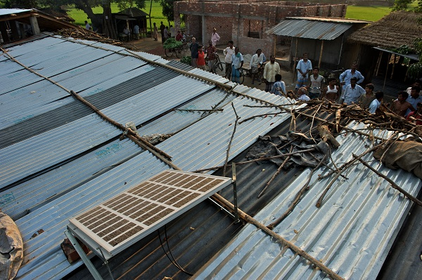 Solar panels are seen installed on the roof of a village grocery store in Khasha Hazipur of Badarganj Upazile in Rangpur district, Bangladesh. (Photo: BRAC/Shehzad Noorani)