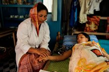 During an antenatal check up that is set up in a village home, Jhorna Akther (30 years old), a BRAC Community Health Worker (CHW) measures Khatidja Akther's blood pressure, who is pregnant for the first time. (Credit: BRAC/Shehzad Noorani)