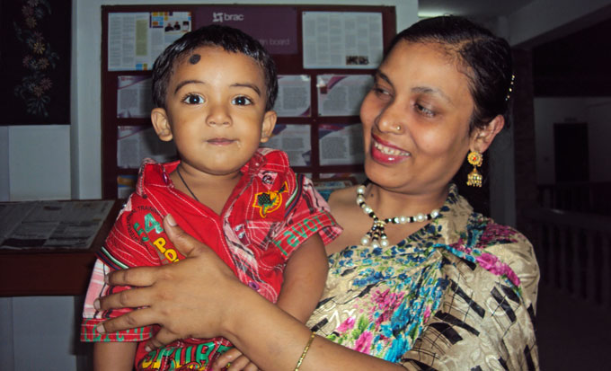 Frontline community health worker Asma Akhter with her second child Arafat
