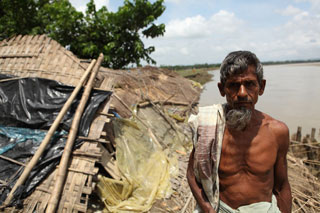 A cyclone victim in Chakaria, Cox's Bazaar, who lost his house in the flood water.
