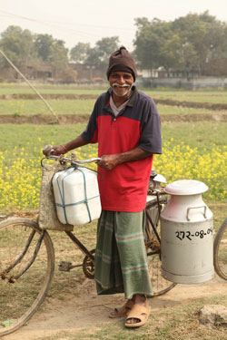A dairy farmer brings his milk to sell to a chilling centre in Rajshahi