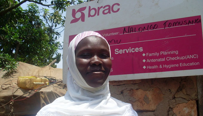 Nalongo Tomusange, a BRAC community health worker outside her office in Wakiso district, Uganda.