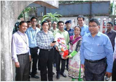Deputy commissioner of Chittagong visits BRAC's microfinance programme.