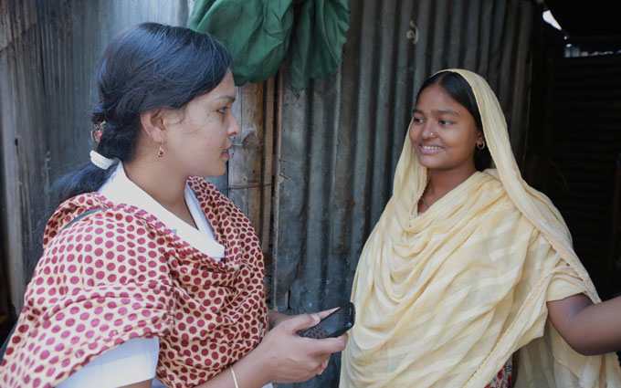 A field officer visits a household of a BRAC client to collect data.