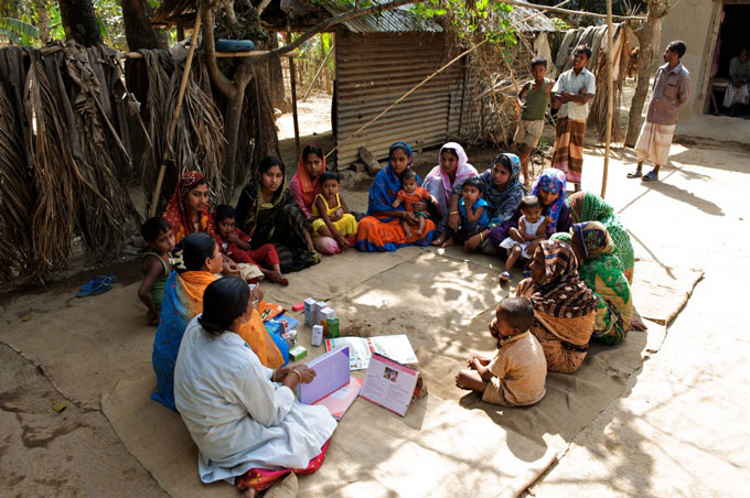 A group of women attend a health forum in a village in northern Bangladesh