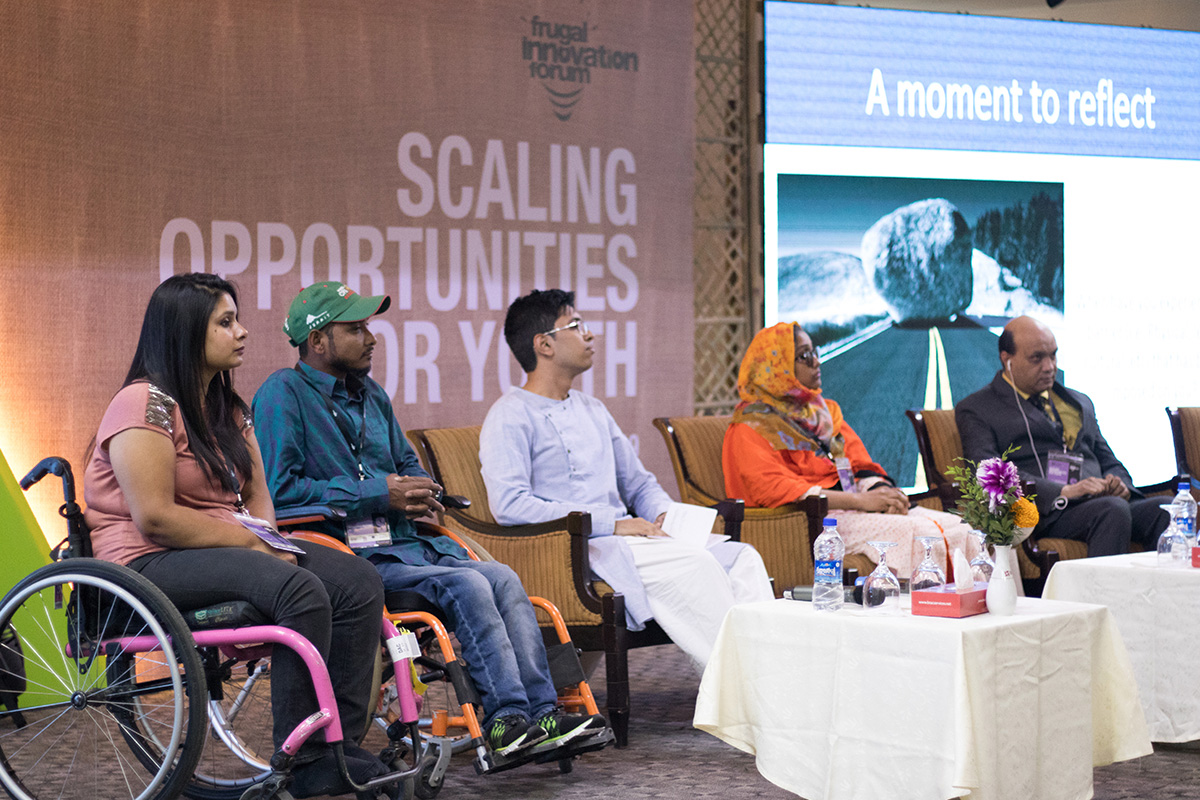 Vashkar Bhattachearjee (far right) speaking at the disability inclusion panel at this year's Frugal Innovation Forum.